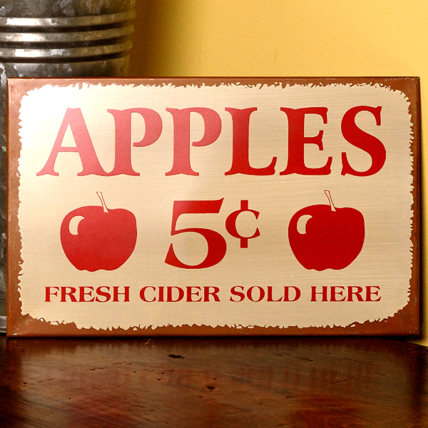vintage metal apple sign